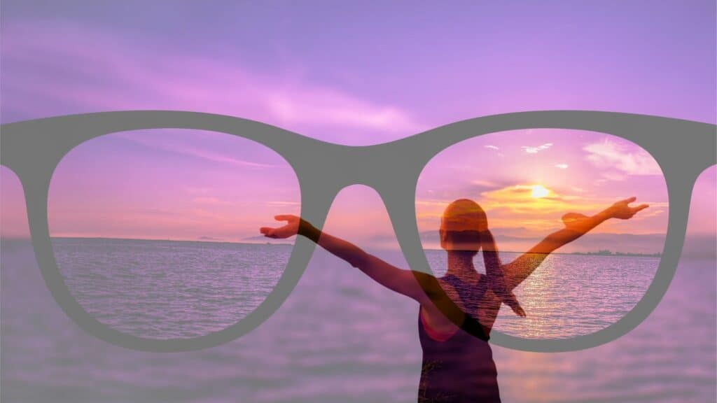 Lady looking at the sunset & reflecting. Pair of spectacles