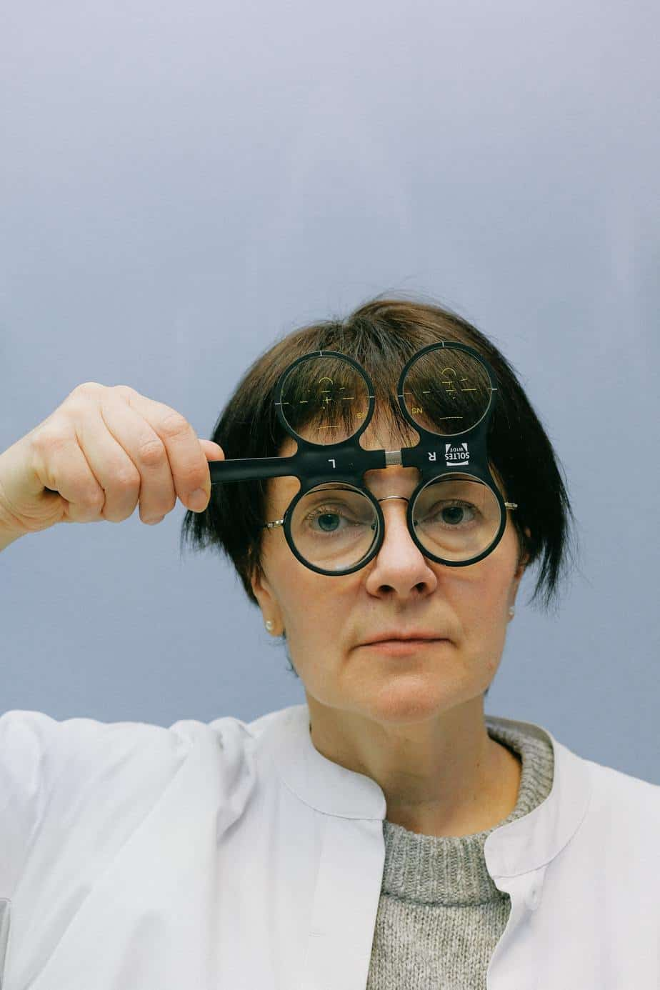 Lady with a spectacle magnifying glass
