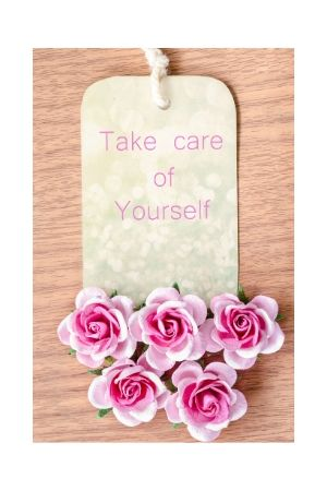 A tag with flowers and message Take Care of Yourself