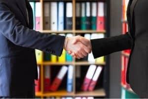 Handshake in front of files