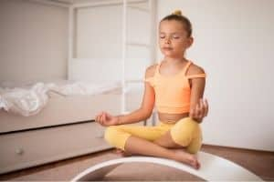 Chid in yoga pose