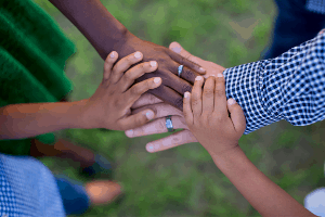 Hands of friends together