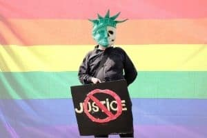 LGBT flag with BLM protestor