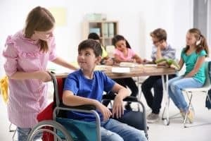Teen showing compassion to differently abled