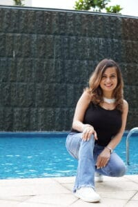 lady near the pool wearing jeans
