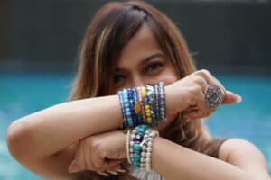 lady wearing wardrobe essentials like bracelets and ring