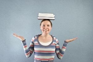 Mom With books on her head