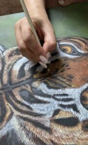 lady painting tiger