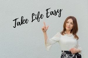 Lady pointing to take life easy